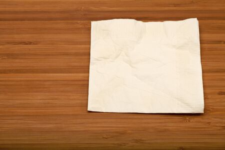 beige cocktail napkin on wooden (Bamboo) table Stock Photo