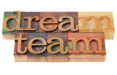 letterpress letters: teamwork concept - dream team words in vintage wooden letterpress printing blocks, stained by color inks, isolated on white
