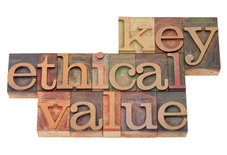 key ethical value - business term in vintage wooden letterpress printing blocks, stained by color inks, isolated on white Stock Photo - 8797507