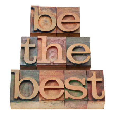 be the best - slogan in vintage wooden letterpress printing blocks, stained by color inks, isolated on white Stock Photo - 8801397