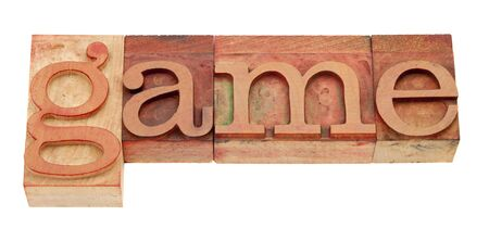 game - isolated word in vintage wood letterpress printing blocks stained by red inks Stock Photo - 8797141