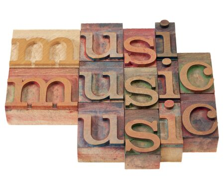music  - isolated word abstract in vintage wood letterpress printing blocks stained by color inks Stock Photo - 8797510