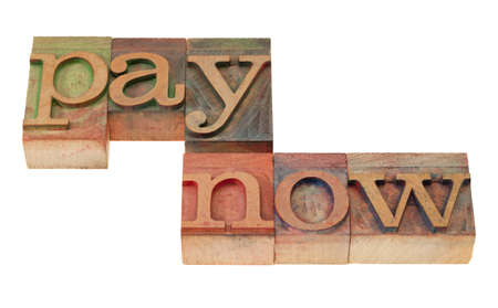 pay now - isolated words in vintage wood letterpress printing blocks stained by color inks Stock Photo - 8797526