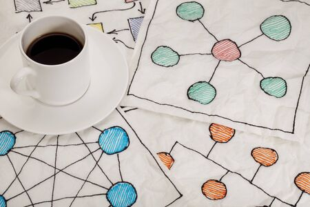 different network schematics sketched on white napkins with espresso coffee cup Stock Photo - 8801405