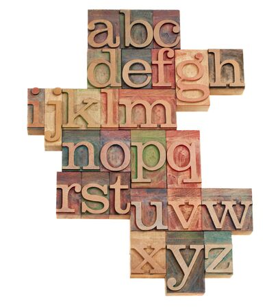 woodtype: alphabet - abstract of vintage wooden letterpress printing blocks stained by color inks, isolated on white