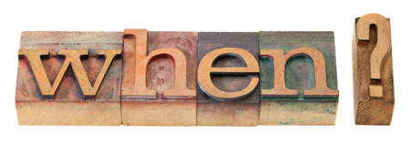 when: when question in vintage wood letterpress printing blocks, stained by color inks