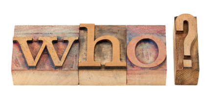 who question in vintage wood letterpress printing blocks, stained by color inks photo