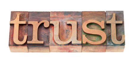 trust: trust word in vintage wooden letterpress printing blocks, stained by color inks, isolated on white Stock Photo