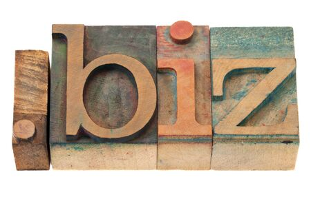 dot biz - internet domain for business,  vintage wooden letterpress printing blocks, stained by ink, isolated on white