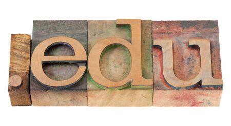 dot edu - internet domain extension for educational institutions in vintage wooden letterpress printing blocks, stained by color inks, isolated on white Stock Photo - 8908174