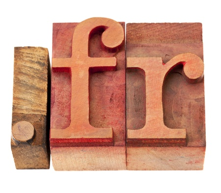 dot fr - internet domain for France in vintage wooden letterpress printing blocks, stained by color inks, isolated on white photo