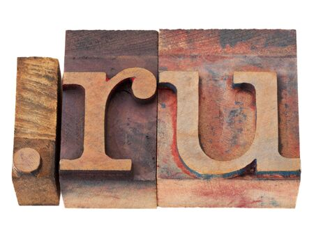 dot ru - internet domain for Russia in vintage wooden letterpress printing blocks, stained by color inks, isolated on white