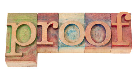 corroboration: proof word in vintage wooden letterpress printing blocks, stained by color inks, isolated on white Stock Photo