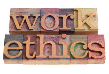 business ethics: work ethics concept -  words  in vintage wooden letterpress printing blocks, stained by color inks, isolated on white