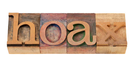 hoax - word in vintage wooden letterpress printing block, stained by color inks, isolated o n white Stock Photo