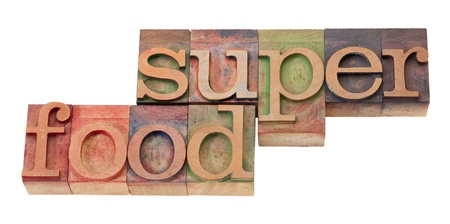 printing block: super food- words in vintage wooden letterpress printing block, stained by color inks, isolated o n white