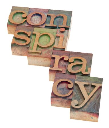 conspiracy word in vintage wood letterpress printing blocks, stained by color inks, isolated on white Stock Photo - 8908230