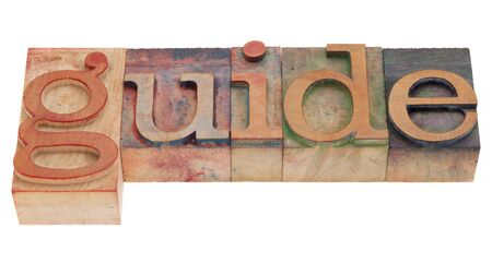 guide word in vintage wood letterpress printing blocks, stained by color inks, isolated on white Stock Photo - 8908227