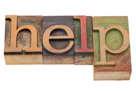 letterpress blocks: help word in vintage wood letterpress printing blocks, stained by color inks, isolated on white Stock Photo