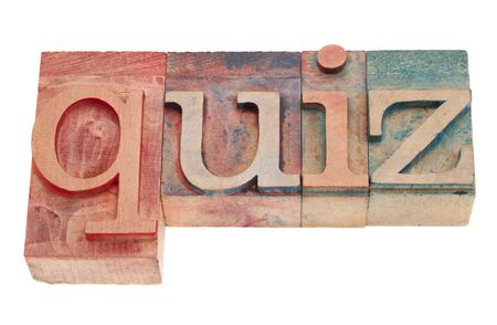 quiz word in vintage wood letterpress printing blocks, stained by color inks, isolated on white Stock Photo - 8908232