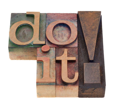 do it - command in vintage wood letterpress printing blocks, stained by color inks, isolated on white Stock Photo - 8987608