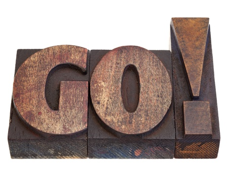 GO - exclamation, start or call for action in vintage wood letterpress printing blocks, isolated on white