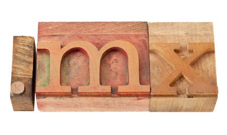 mx: dot mx  - internet domain for Mexico in vintage wooden letterpress printing blocks, stained by color inks, isolated on white