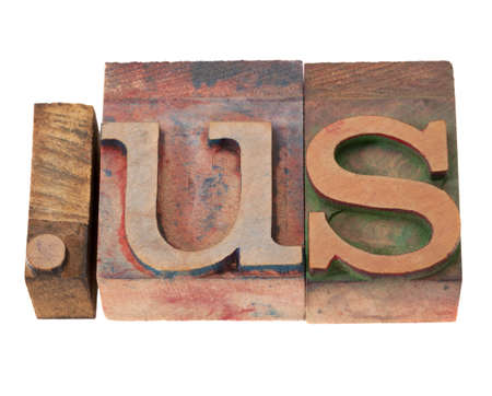 dot us - internet domain for United States in vintage wooden letterpress printing blocks, stained by color inks, isolated on white blocks, stained by color inks, isolated on white photo