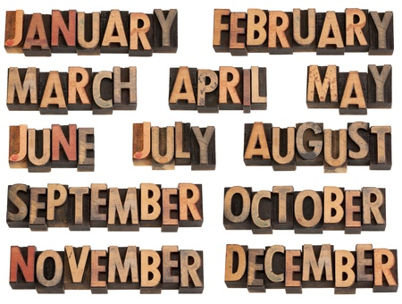 12 months of the year from January to December in vintage wood letterpress printing blocks, isolated on white photo