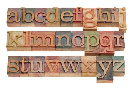 woodtype: complete English alphabet (lowercase) in vintage wooden letterpress printing blocks stained by color inks, isolated on white