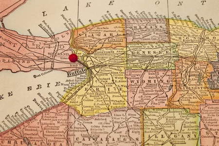 map pin: Buffalo and part of New York state on vintage 1920s map with a red pushpin Stock Photo