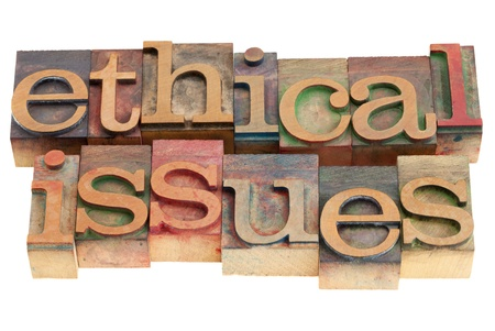 ethics: ethical issues words in vintage wood letterpress printing blocks, isolated on white Stock Photo