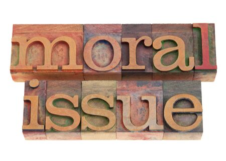 moral issue phrase in vintage wood letterpress printing blocks, isolated on white Stock Photo - 9063434