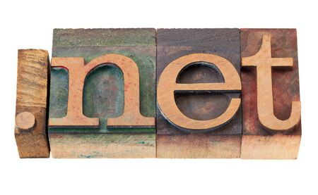 do net - network internet domain in vintage wooden letterpress printing blocks, stained by color inks, isolated on white