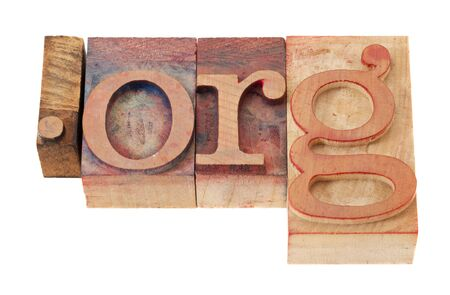 dot org - non-profit organization internet  domain extension in vintage wooden letterpress printing blocks, stained by color inks, isolated on white Imagens