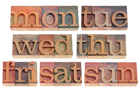 7 days of week (first 3 letters) in vintage wood letterpress printing blocks, isolated on white photo