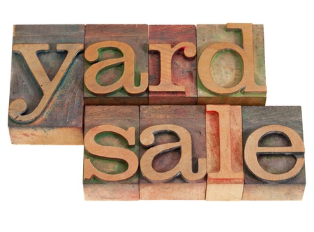yard sale words in vintage wood letterpress printing blocks, stained by color inks, isolated on white photo