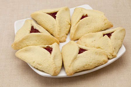 apricot hamantaschen cookies  on a plate - a traditional pastry in Ashkenazi Jewish cuisine for holiday of Purim Stock Photo - 9063453