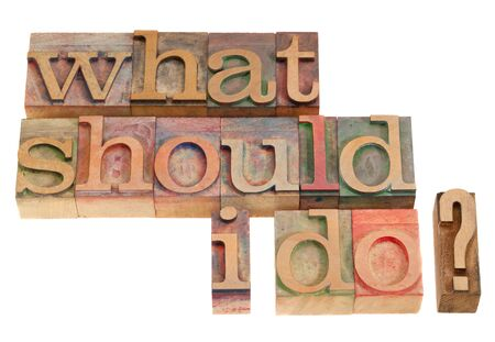 letterpress blocks: What should I do question in vintage wood letterpress printing blocks, isolated on white Stock Photo