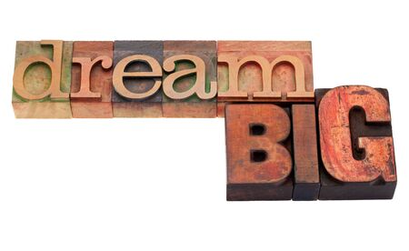 woodtype: dream big phrase in vintage wood letterpress printing blocks, isolated on white Stock Photo
