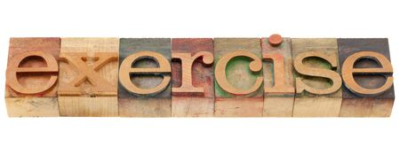 woodtype: exercise word in vintage wood letterpress printing blocks, isolated on white