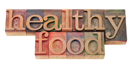 healthy food phrase in vintage wood letterpress printing blocks, isolated on white Stock Photo - 9157427