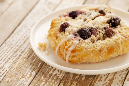 cherry cheese danish pastry on white plate against grunge wood table Stock Photo - 9157453