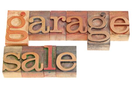 garage sale words in vintage grunge wood letterpress printing blocks, isolated on white Stock Photo - 9157458