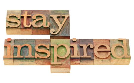 inspiration concept - stay inspired words in vintage grunge wood letterpress printing blocks, isolated on white