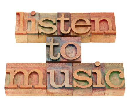 suggestion: listen to music inspirational suggestion in vintage wood letterpress printing blocks, isolated on white