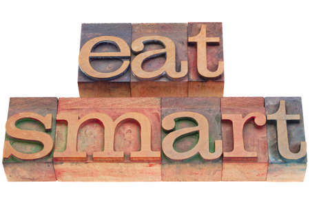 diet concept - eat smart phrase in vintage wood letterpress printing blocks isolated on white