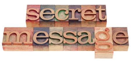 secret message phrase in vintage wood letterpress printing blocks isolated on white Stock Photo - 9283776