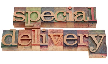 special delivery phrase in vintage wood letterpress printing blocks isolated on white Stock Photo - 9283778