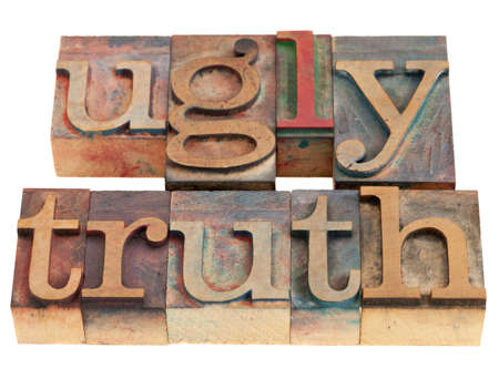 ugly truth phrase in vintage wood letterpress printing blocks isolated on white, selective focus Stock Photo - 9283777